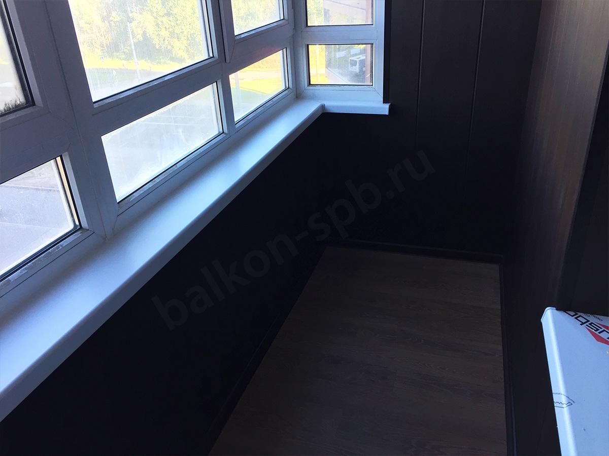 Обшивка балкона панелями Венге